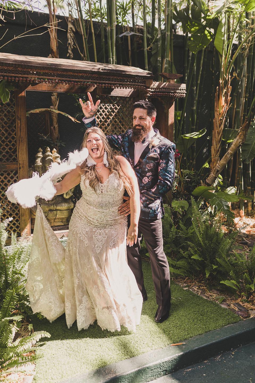 bride and groom pose in Las Vegas garden