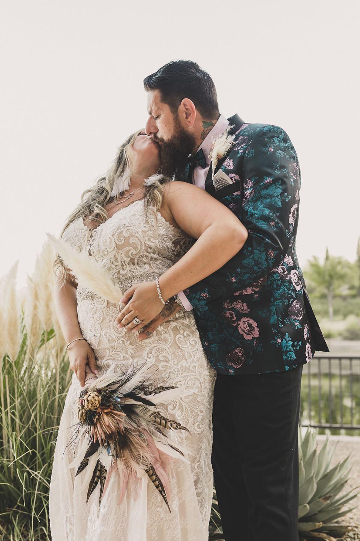 newlyweds kiss during The Westin Lake Las Vegas portraits