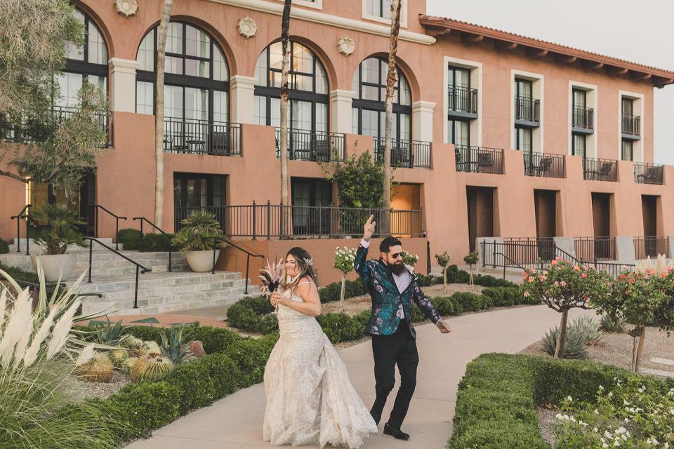 bride and groom enter Las Vegas wedding reception