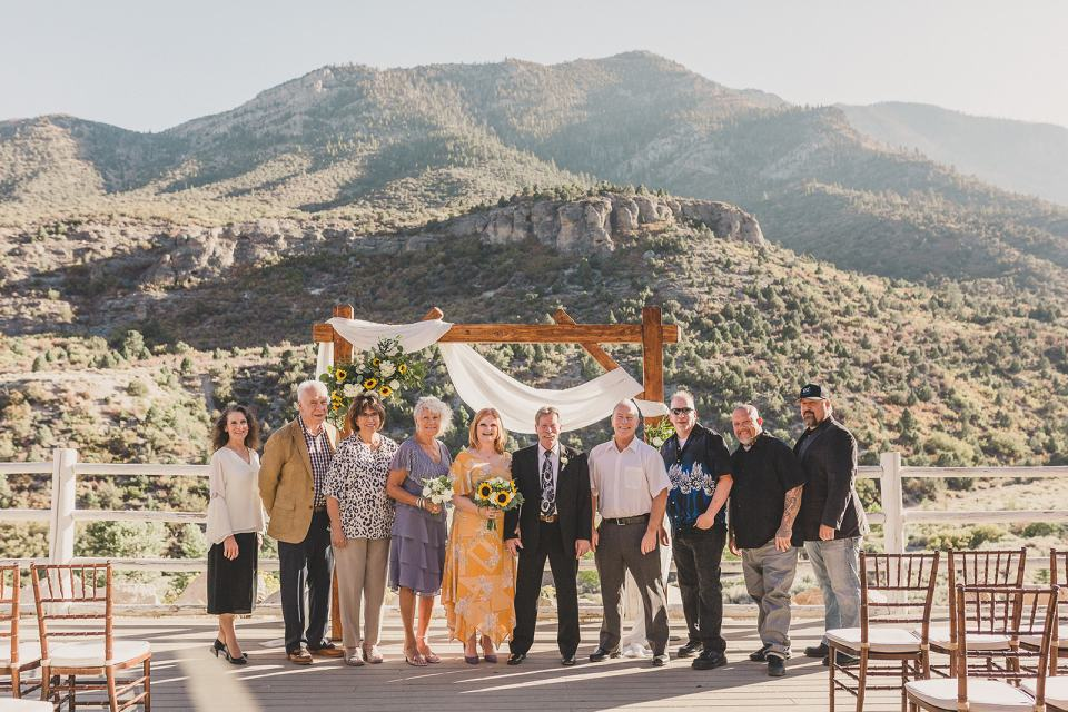 bride and groom pose with guests after Mt Charleston Lodge Microwedding
