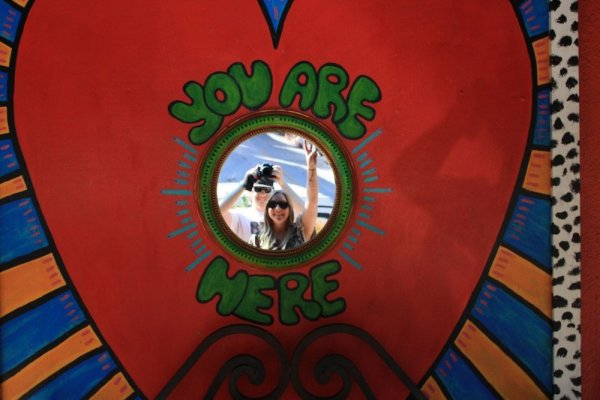 """A sign in Laurel Canyon that says """"You are Here"""" with a mirror"""