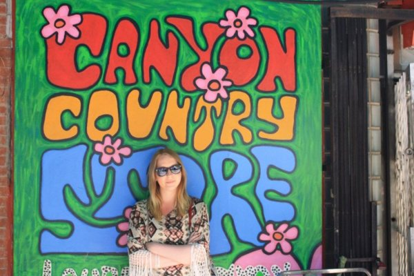 Taylor in front of the Canyon Country Store sign in Laurel Canyon