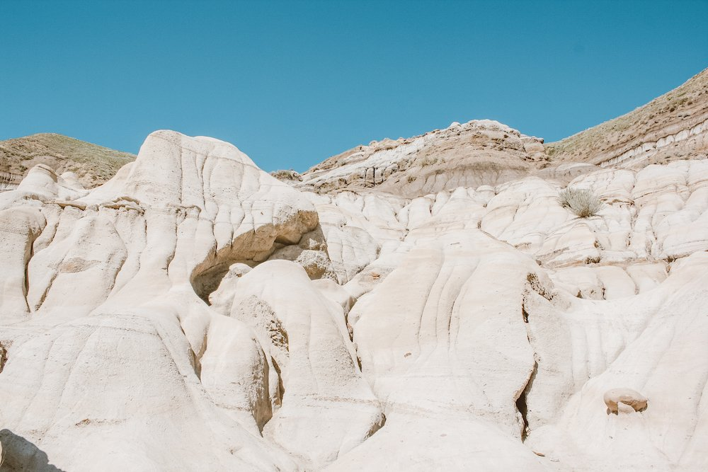 Hoodoos and carved rocks in the midday sun at Drumheller, Alberta Canada