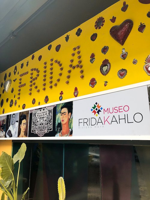 "A yellow ""frida"" sign outside of the Frida museum in Playa del Carmen, Mexico"