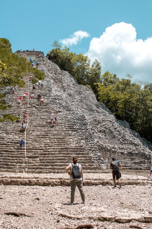 Gazing at the main pyramid at coba ruins in quintana roo, mexico