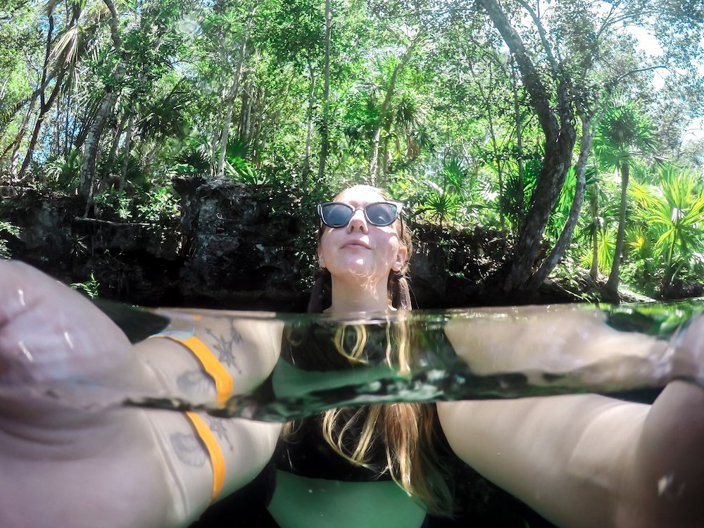 Taylor takes a selfie in the jardin del eden cenote in mexico