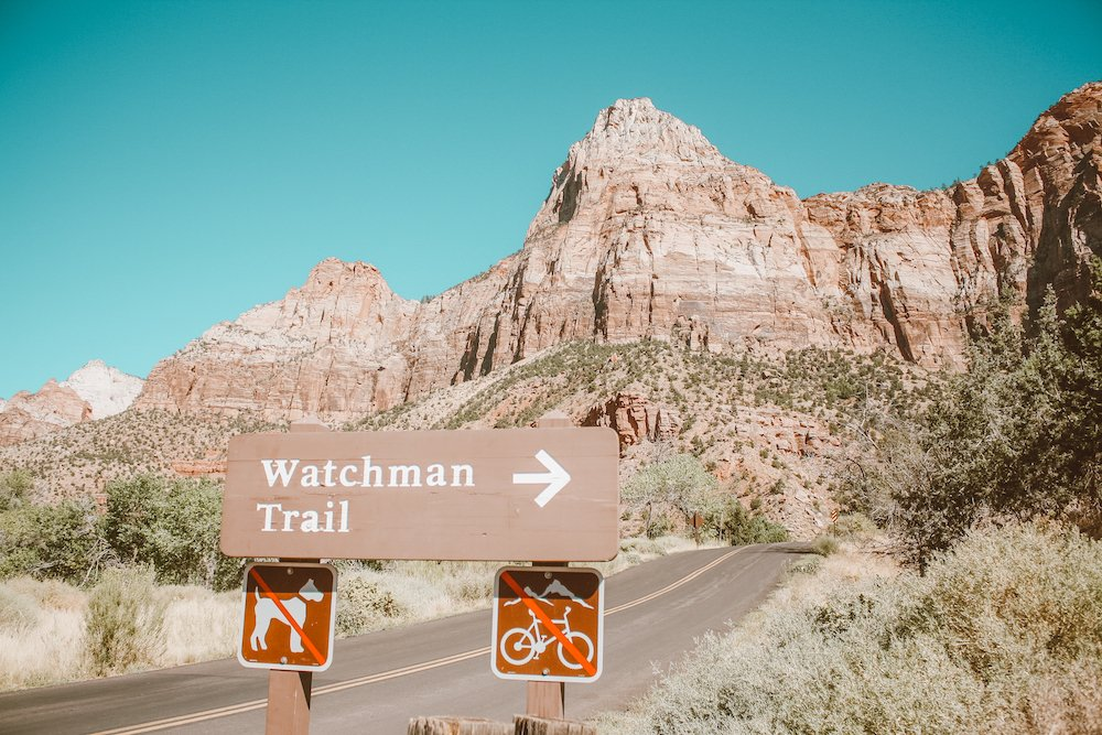 A sign points to Watchman Trail in Zion National Park, Utah