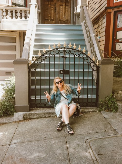Taylor sitting in front of The Grateful Dead House in Haight Ashbury San Francisco