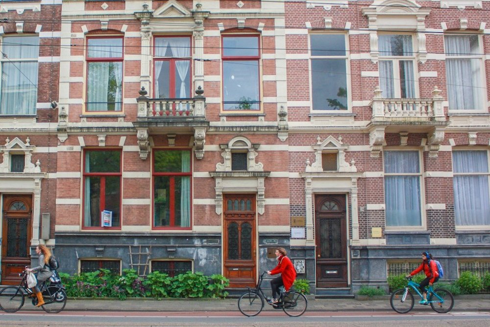 Cyclists make their way through the old streets of Amsterdam, The Netherlands