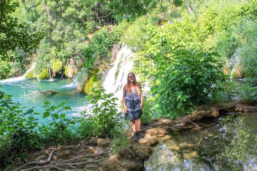 Krka National Park with water pools, greenery, and a waterfall in the background