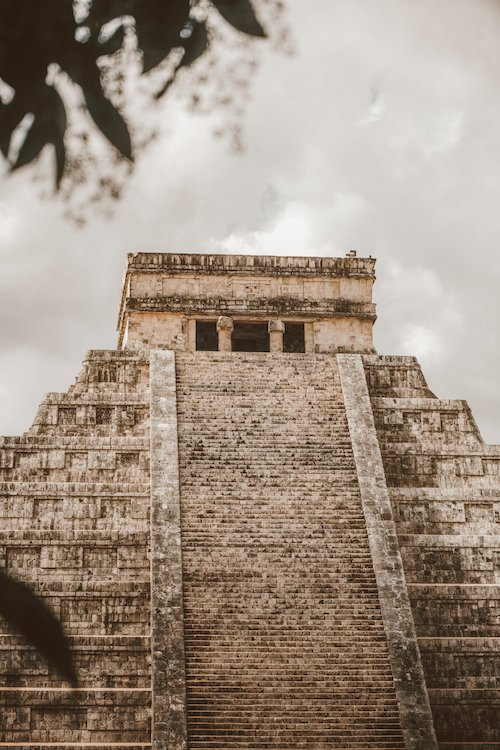 Stairs lead up to a viewing platform at one of the main temples of Chichen Itza, Mexico