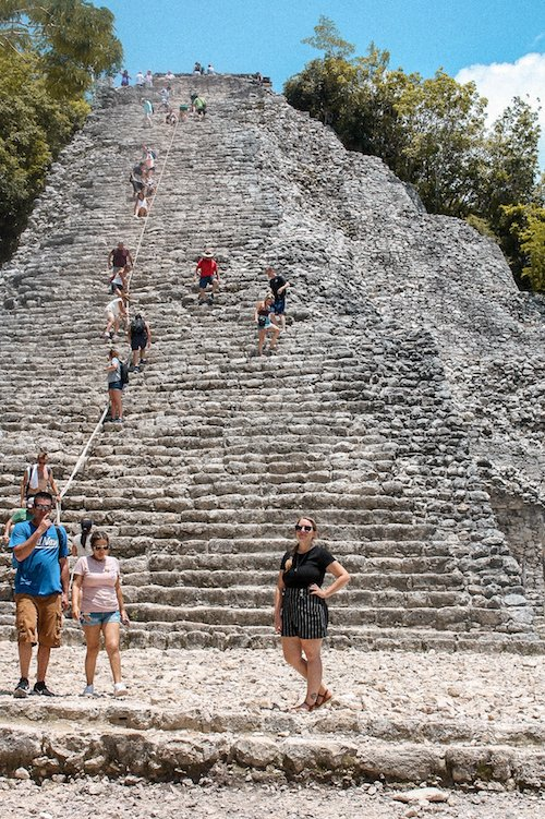 People climbing the main pyramid at the Coba Ruins in Mexico