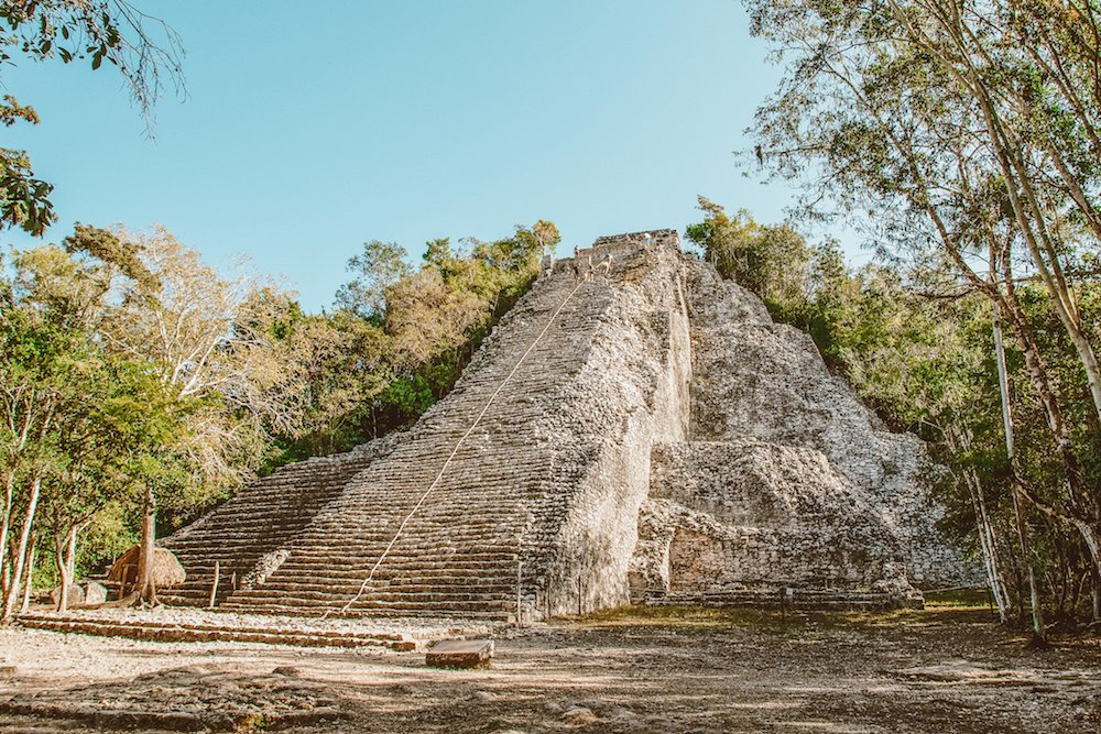 The main pyramid in Coba Mexico, with people on top of it