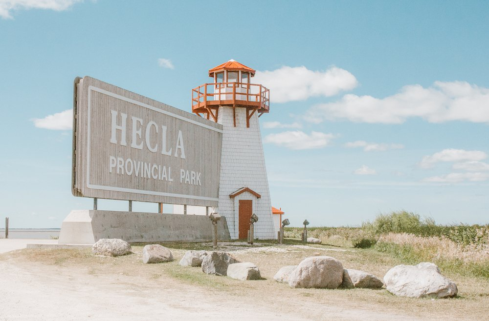 The welcome sign with a lighthouse at Hecla Provincial Park in Manitoba Canada