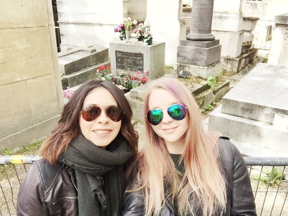 My friend Trellawny and i in front of Jim Morrison's grave in Paris, France