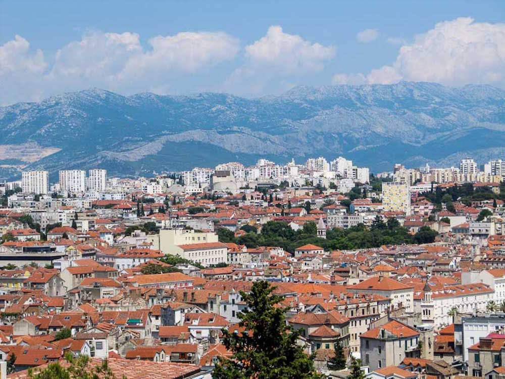 An overhead shot of downtown Split, Croatia with mountains in the background
