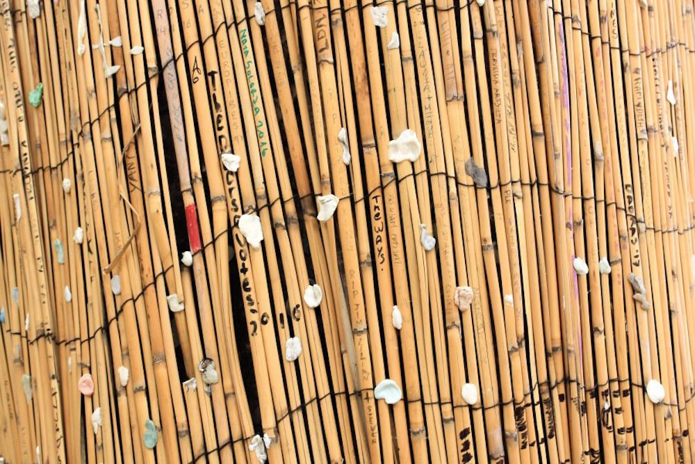 Chewing gum stuck to bamboo sticks at Jim Morrison's gravesite in Paris, France