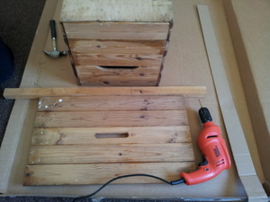 Wooden box, drill and hammer