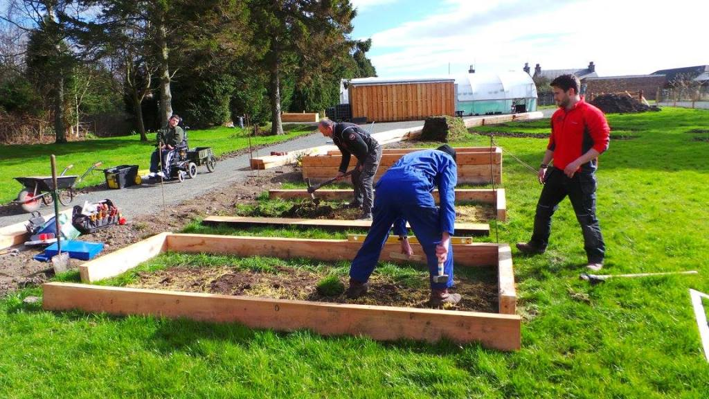 Volunteers constructing raised beds