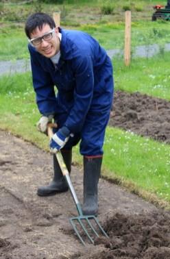 A man raking