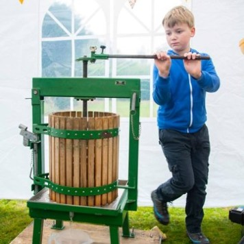 A child using an apple press