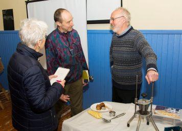 A photo participants chatting to John Marshall