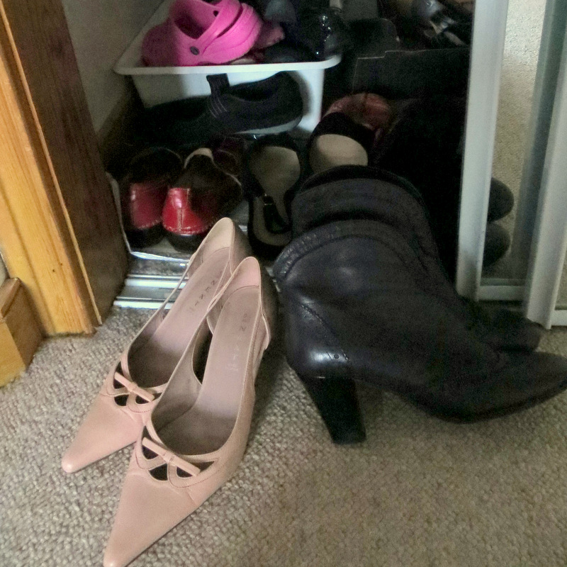 A photo of a pile of women's shoes