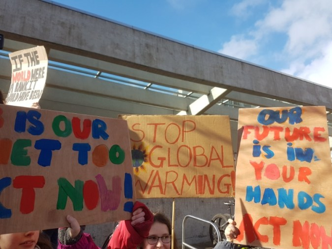 Kids with protest placards about climate change