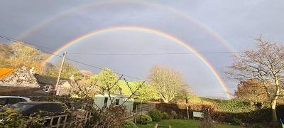 Rainbow over a village