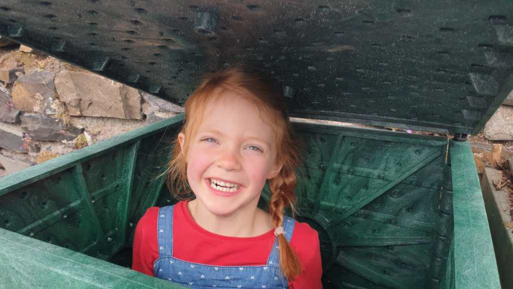 Photo of a child in a compost bin
