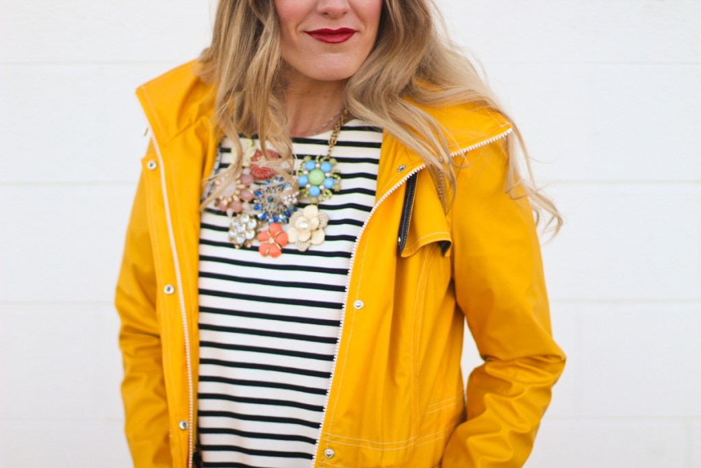 yellow rain jacket, striped dress, statement necklace
