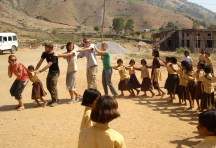 Students enjoying a dance with village school children on the outskirts of Udaipur