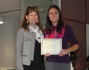Margot receives her award from College of Science Dean Ginger Carney