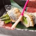 愛知の銘酒 醸し人九平次の酒粕に漬け込んで焼き上げた 太刀魚のアスパラ巻き(愛知)
