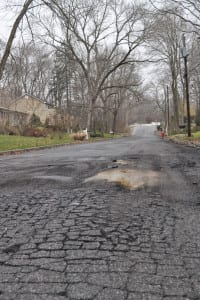Part of Pleasant Drive in East Setauket needs to be repaired as of Tuesday. Photo by Elana Glowatz