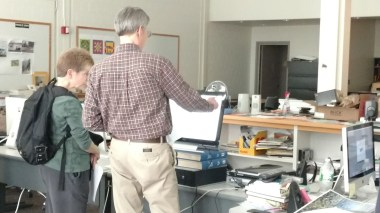 Donna Eschenbrenner and Rod Howe of THC critiquing student work