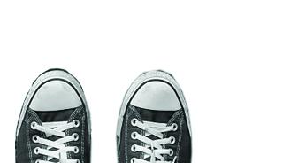 top half of black converse sneakers