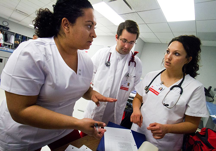 3 SCC Nursing students going over paperwork