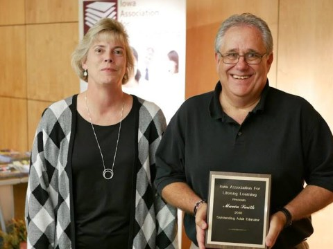 Marv Smith receiving IALL Outstanding Educator for 2018 Award