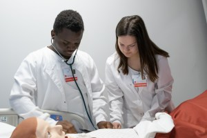 Two students working in nursing lab
