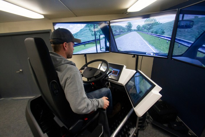 Student driving the Truck Driving Simulator