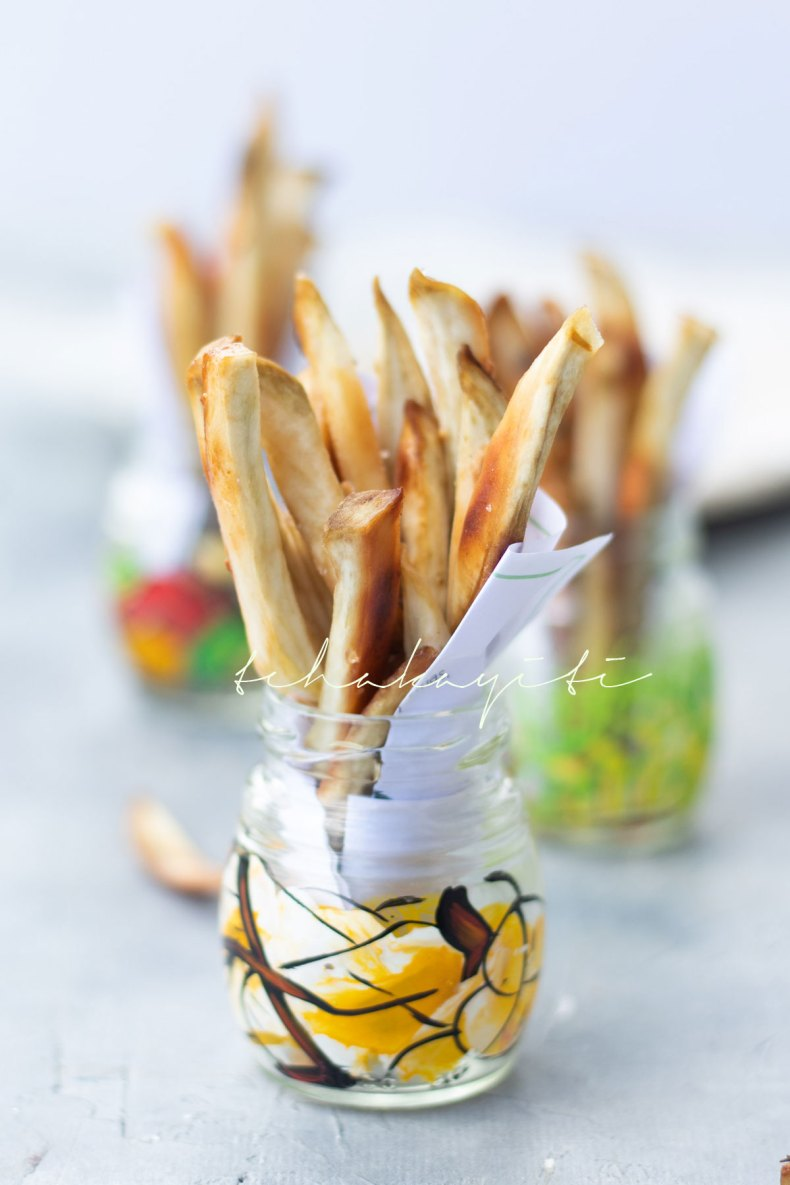 These oven baked Haitian sweet potato fries are seasoned with salt, pepper and fresh garlic. | tchakayiti.com