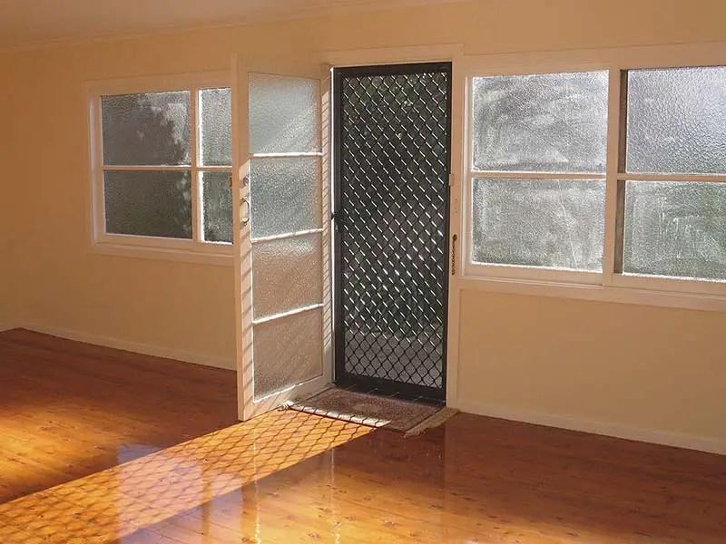 an empty room with a black screen door