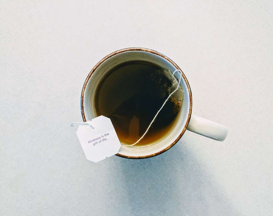 The Health Benefits of Caffeine - Photo from above of a mug with a teabag in it