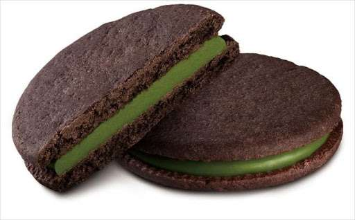 Photo of half of a Meiji Rich Matcha Biscuit leaning on another Meiji Rich Matcha Biscuit.