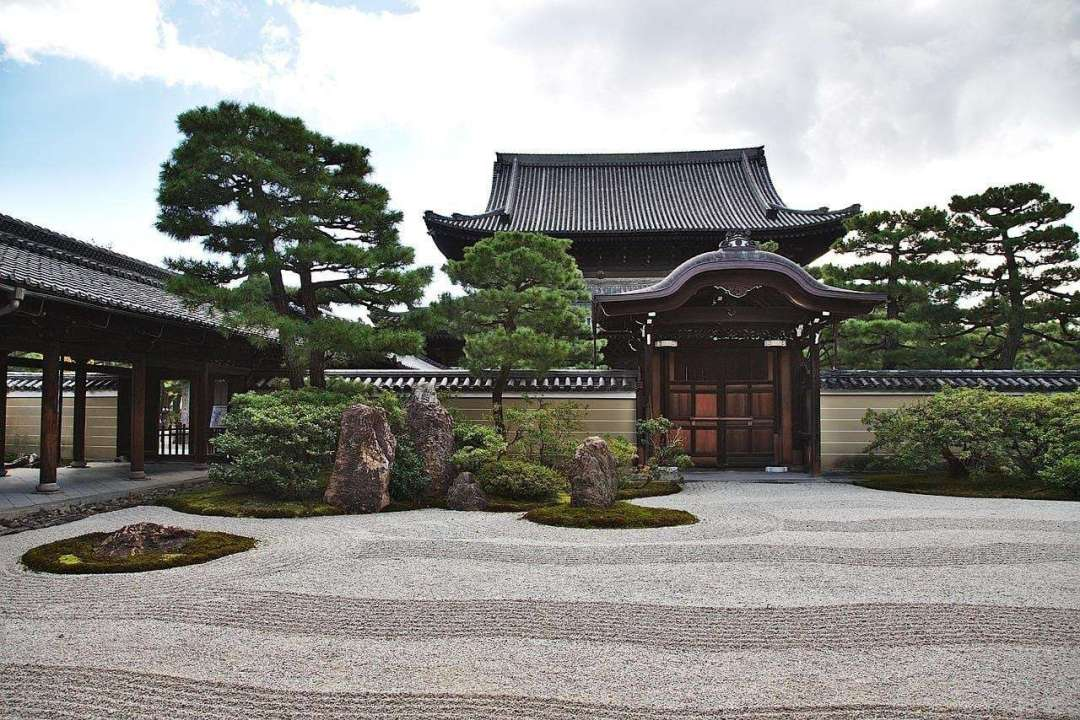 Tea Time for Turbulent Times - Photo of a Japanese temple with a zen garden