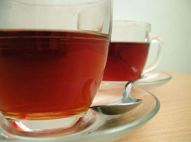 T Ching Classics: Tea Bringing People Together - Image of two teacups side-by-side