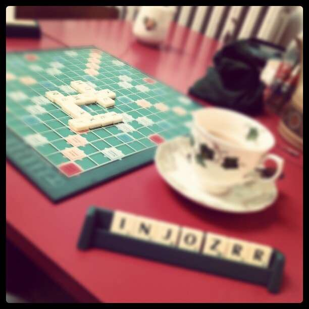 Online Scrabble with Oolong - Photo of scrabble board and a teacup with saucer