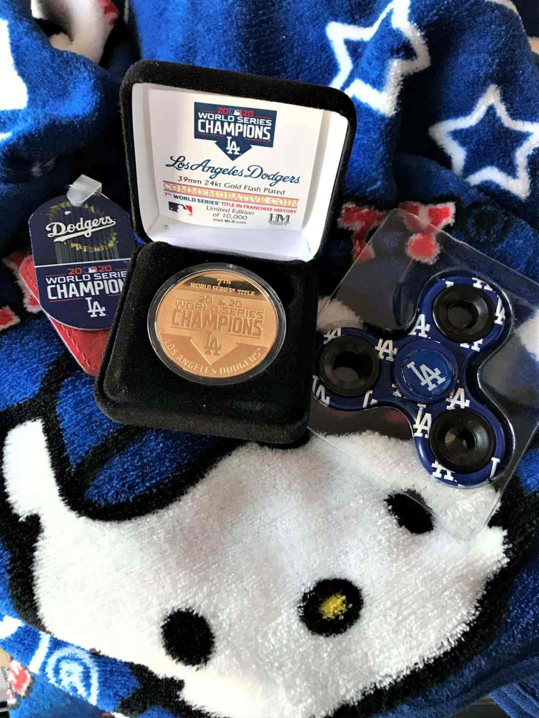 Connecting Baseball With Tea - LA Dodgers World Series commemorative items on a Hello Kitty blanket