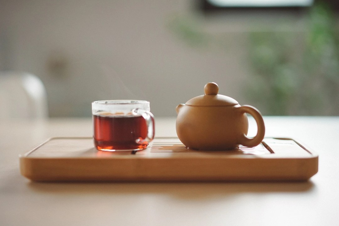 Tray with tea and teapot, then the leaves can be used to remove smells